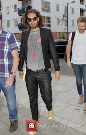 Russell Brand - Russell Brand arriving at the Proud Archivist in Hackney, London. at Proud Archivist - London, United Kingdom...