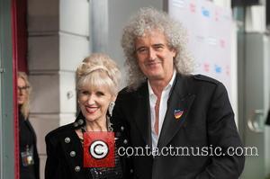 Anita Dobson and Brian May