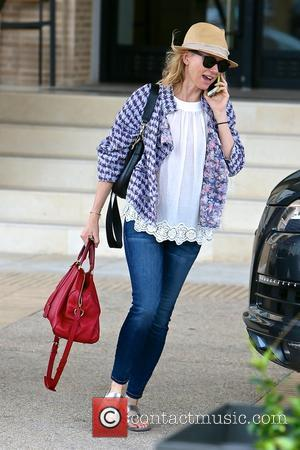 Naomi Watts - Naomi Watts leaving Barneys of New York while talking on her iPhone - Los Angeles, California, United...