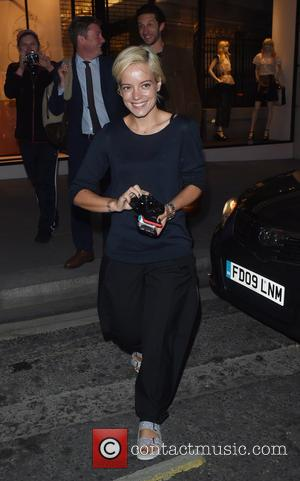 Lilly Allen - Lilly Allen is seen getting all camera happy with the paps as she is pictured out and...