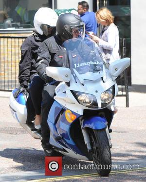Amanda Holden - Amanda Holden seen out in London leaving on a motorbike - London, United Kingdom - Thursday 11th...