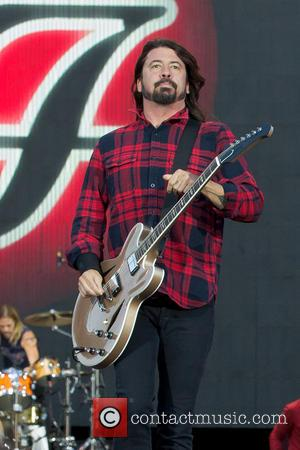 Dave Grohl Serenades Crying Fan On Stage During Colorado Concert