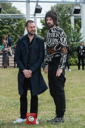 Serge Pizzorno and Guest - Burberry Prorsum Menswear SS15 arrivals held at Kensington Gardens. - London, United Kingdom - Monday...