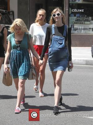 Jaime King and Joey King - Pregnant Jaime King showing off her baby bump in a denim overall-style mini-dress out...