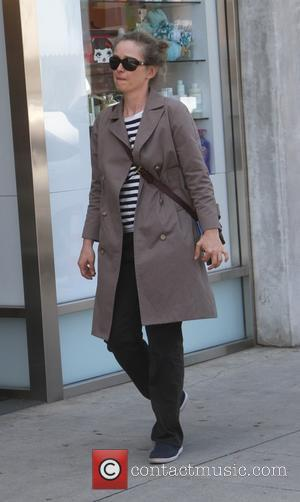 Julie Delpy - Julie Delpy goes shopping in Beverly Hills wearing sunglasses and a rain mac - Los Angeles, California,...