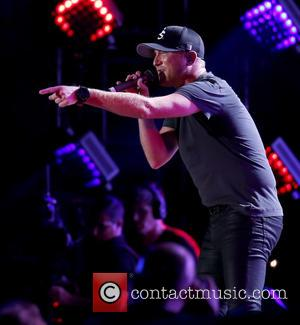 Cole Swindell Video Calls Dustin Lynch Mid-show To Surprise Young Fan