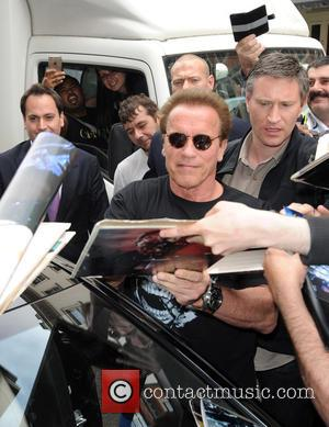 Arnold Schwarzenegger - Arnold Schwarzenegger signs for fans as he leaves Claridges - London, United Kingdom - Wednesday 17th June...