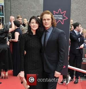 Caitriona Balfe and Sam Heughan - Arrivals at the Edinburgh International Film Festival Opening Night Gala red carpet. at Festival...
