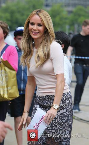 Amanda Holden and Philip Schofeild - Amanda Holden filming This Morning outside on the Southbank - London, United Kingdom -...