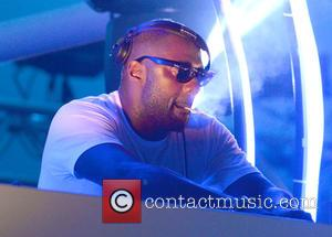 Idris Elba - Idris Elba smokes a hand-rolled cigarette while playing a DJ set at the Goodwood Racecourse in West...