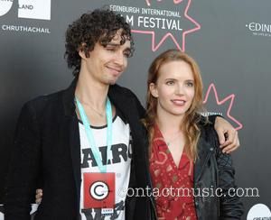 Robert Sheehan and Tamzin Merchant