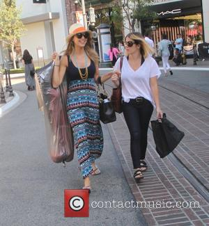 Arielle Kebbel - The Vampire Diaries actress, Arielle Kebbel goes shopping at The Grove in Hollywood with a friend -...
