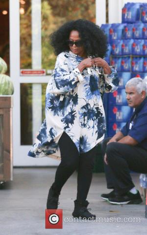 Diana Ross - Diana Ross untangles her heaphones clipped to her top as she leaves Bristol Farms after shopping for...