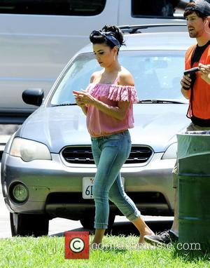 Eva Longoria - Actress Eva Longoria films a scene for 'Lowriders' at Elysian Park in Los Angeles with co-star Demian...
