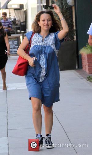 Jennifer Meyer - Tobey Maguire's wife, jewelry designer Jennifer Meyer goes shopping in Beverly Hills wearing a blue maternity dress...