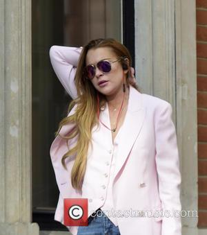 Lindsay Lohan - Lindsay Lohan seen in pink blazer outside a hotel smoking at w1 - London, United Kingdom -...