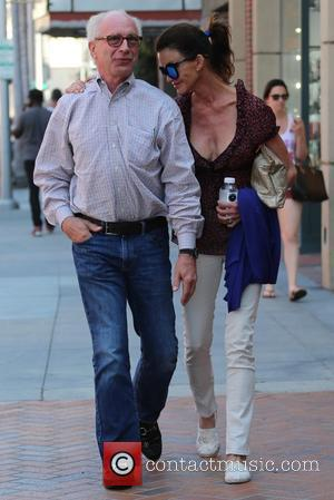 Janice Dickinson and Dr Robert Gerner - Janice Dickinson and her fiancé Dr Robert Gerner stroll together in Beverly Hills...