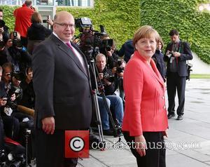 Peter Altmaier and Angela Merkel
