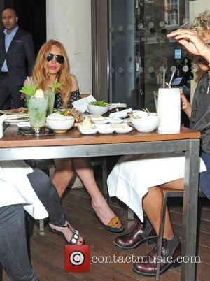 Lindsay Lohan - Lindsay Lohan dines at Roka Mayfair with friends - London, United Kingdom - Wednesday 24th June 2015