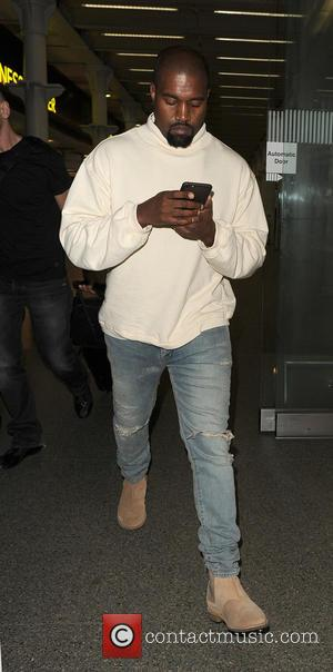 Kanye West - Kanye West arrives in London after catching the Eurostar from Paris - London, United Kingdom - Thursday...