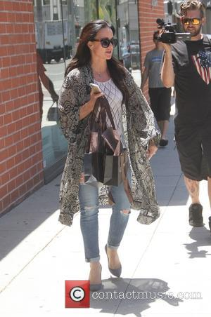 Kyle Richards - Kyle Richards goes shopping at Sama eyewear in Beverly Hills wearing skinny jeans and a long tribal...