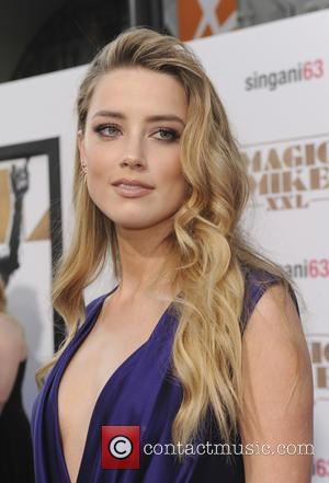 Amber Heard - Premiere of Warner Bros. Pictures' 'Magic Mike XXL' at the TCL Chinese Theatre IMAX in Hollywood -...