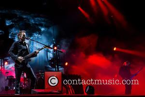 Muse, Matt Bellamy, Christopher Wolstenholme and Dominic Howard