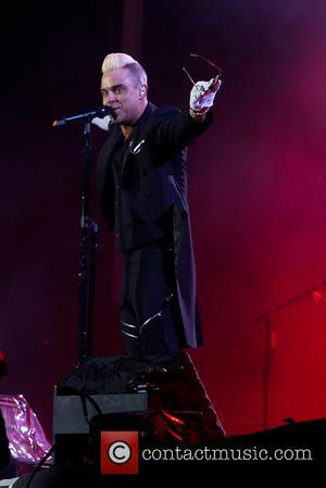 Robbie Williams Cancels Asian Tour