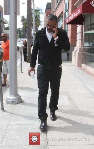 Rick Fox - Actor Rick Fox talks on his cellphone as he leaves an office in Beverly Hills - Los...