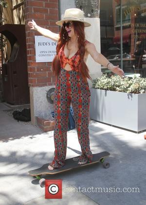 Phoebe Price - Phoebe Price rides a skateboard in Beverly Hills - Los Angeles, California, United States - Monday 29th...