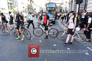 Cyclists stage 'die-in' after death of Ying Tao at notorious City junction by the Bank of England - London, United...