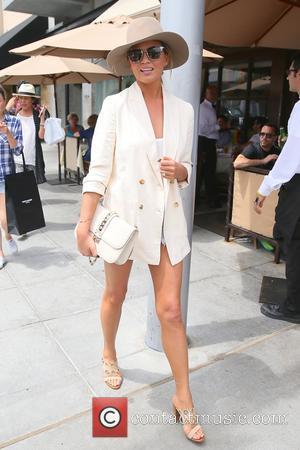 Chrissy Teigen - Chrissy Teigen seen leaving Porta Via restaurant after having lunch with her mum. at Beverly Hills -...