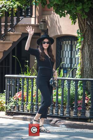 Liv Tyler - Liv Tyler is all smiles as she celebrates her 38th birthday with fiance Dave Gardner and sons...