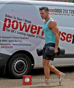 Mark Wright - Mark Wright unloads gym equipment and helps with the installation of his new state-of-the-art home gymnasium. at...