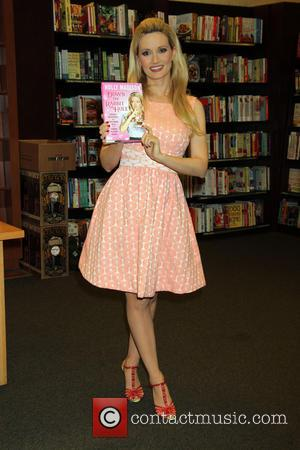 Holly Madison - Holly Madison attends a signing for her new book