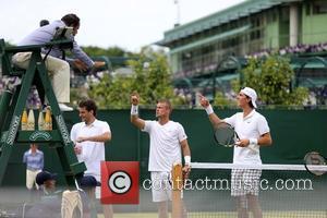 Leyton Hewitt and Kokkinakis - 2015 Wimbledon Championship - Day 3 - Leyton Hewitt disputing a call in doubles match...