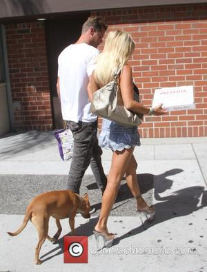 Shauna Sand and Stevie Simpson - Former Playboy Playmate Shauna Sand wears lucite platform heels to pick up pizza with...