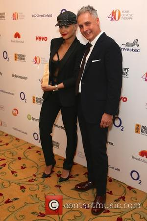 Rita Ora and Guest - Nordoff Robbins O2 Silver Clef Awards held at Grosvenor House at Grosvenor House - London,...