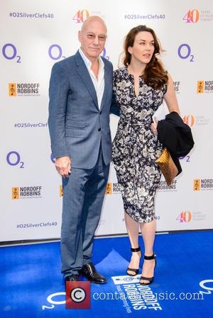 Patrick Stewart and Sunny Ozell - Nordoff Robbins O2 Silver Clef Awards held at Grosvenor House - Arrivals at Grosvenor...