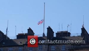 View - Flags on the Edinburgh City Council Chambers were flying at half mast in respect for the victims of...