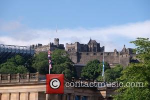 View - Flags on Edinburgh Castle and The Scottish National Gallery were flying at half mast in respect for the...