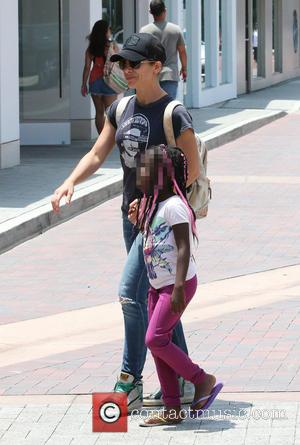 Jillian Michaels, Heidi Rhoades and Lukensia Michaels Rhoades - Jillian Michaels and her partner Heidi Rhoades out shopping with their...