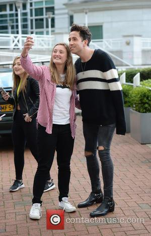 Nick Grmshaw - X Factor Judge Nick Grimshaw poses for photographs with fans outside his Manchester hotel at x factor...