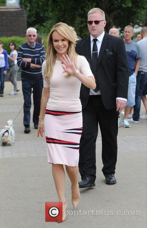 Amanda Holden - Gok Wan and Amanda Holden seen filming outside on the SouthBank for This Morning. - London, United...