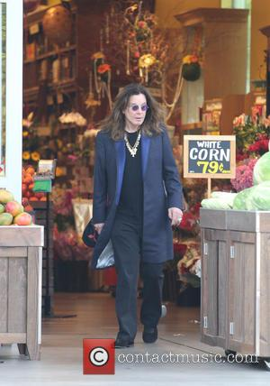 Ozzy Osbourne - Ozzy Osbourne shopping at Bristol Farms in Beverly Hills wearing a long coat and gold chain necklace...