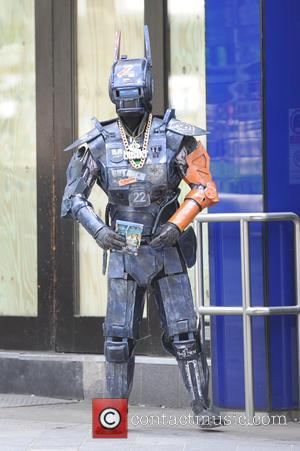 Chappie - A person dressed as Chappie, the police droid from the movie of the same name, at Global Radio...