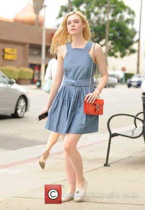 Elle Fanning - Elle Fanning wears a blue dress to the nail salon - Los Angeles, California, United States -...
