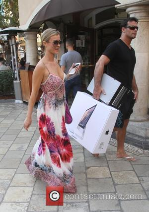 Joanna Krupa and Romain Zago - Joanna Krupa goes shopping at The Grove in Hollywood with her husband - Los...