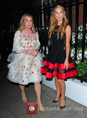 Kathy Hilton and Paris Hilton - Paris Hilton and her sister Nicky Hilton are joined by their mother Kathy Hilton...