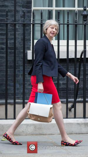 Home Secretary Theresa May - ome Secretary Theresa May leaving number 10 Downing Street on the day of Summer Budget...